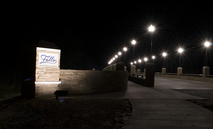 Natural Concepts light fixtures lighting a road way and neighborhood sign