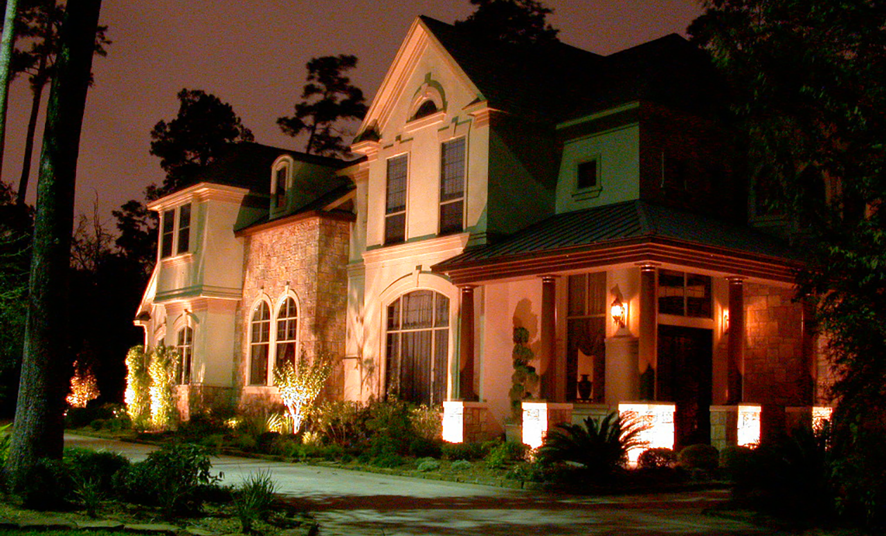 Side view of a house being lighted by soft yellow lights